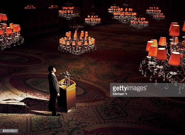 Man standing in an empty ballroom