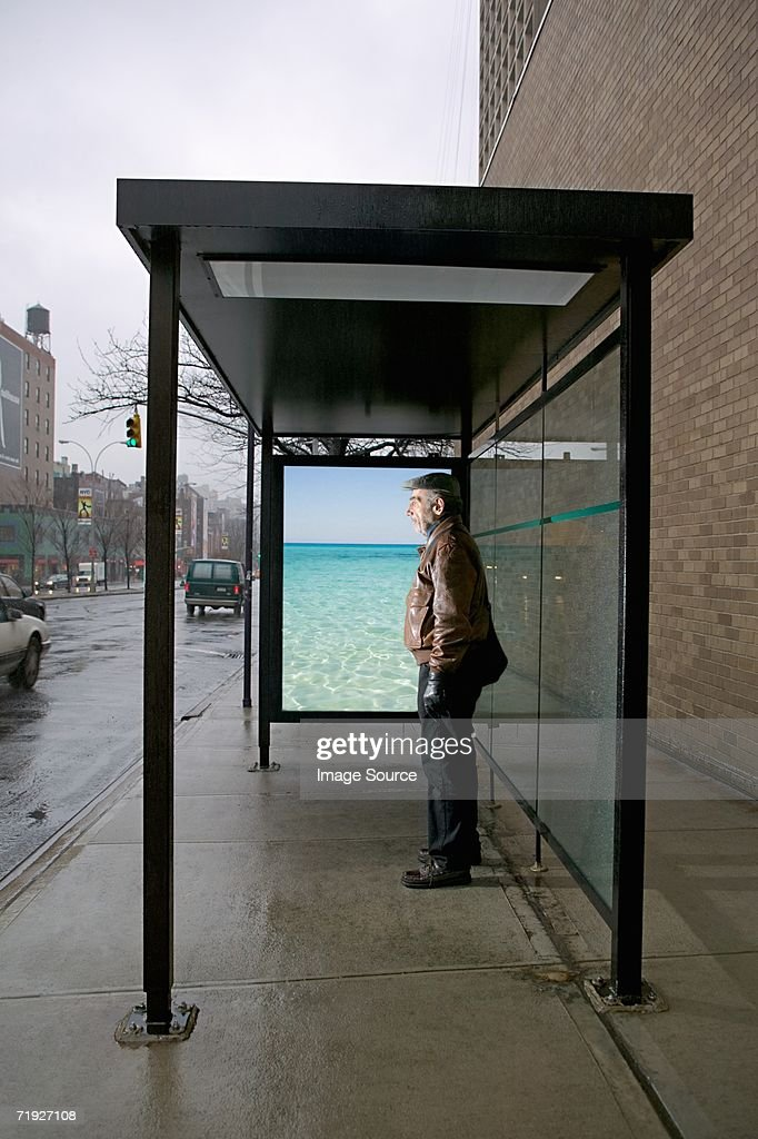 Man standing in bus shelter