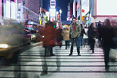 Man standing in busy intersection in Times Square