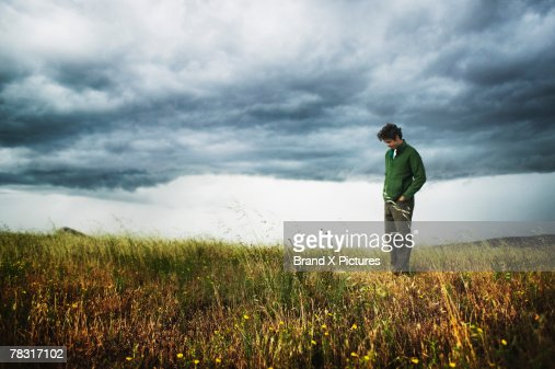 Man standing in field : Stock Photo