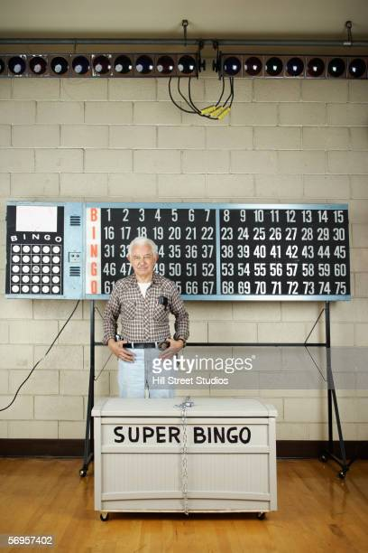 Man standing in front of bingo board