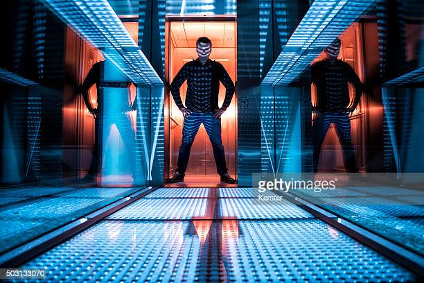 man standing in front of elevator to hell