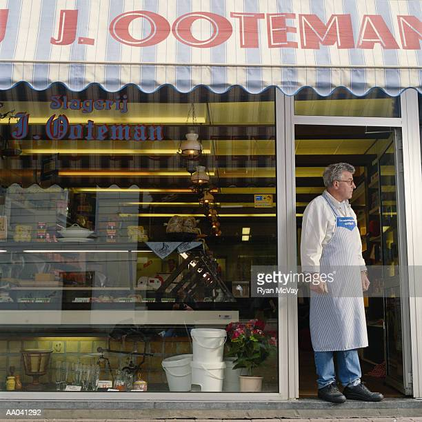 Man Standing in Front of His Butcher Shop