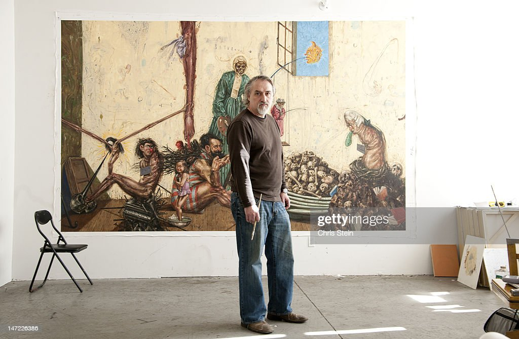 Man standing in front of his painting