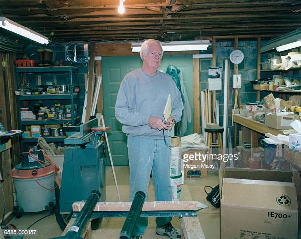 Man Standing in Garage