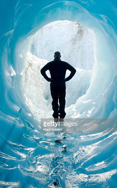 Man Standing in Glacier Ice Cave