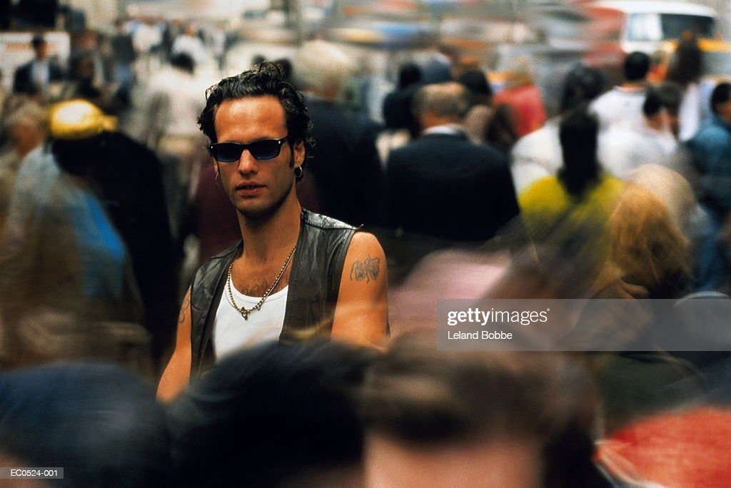 Man standing in moving crowd, New York City, USA : Stock Photo