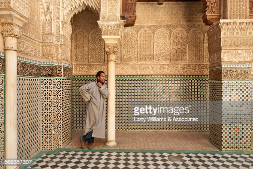 Man standing in ornate church with tile mosaics, Fes, Fes-Boulemane, Morocco