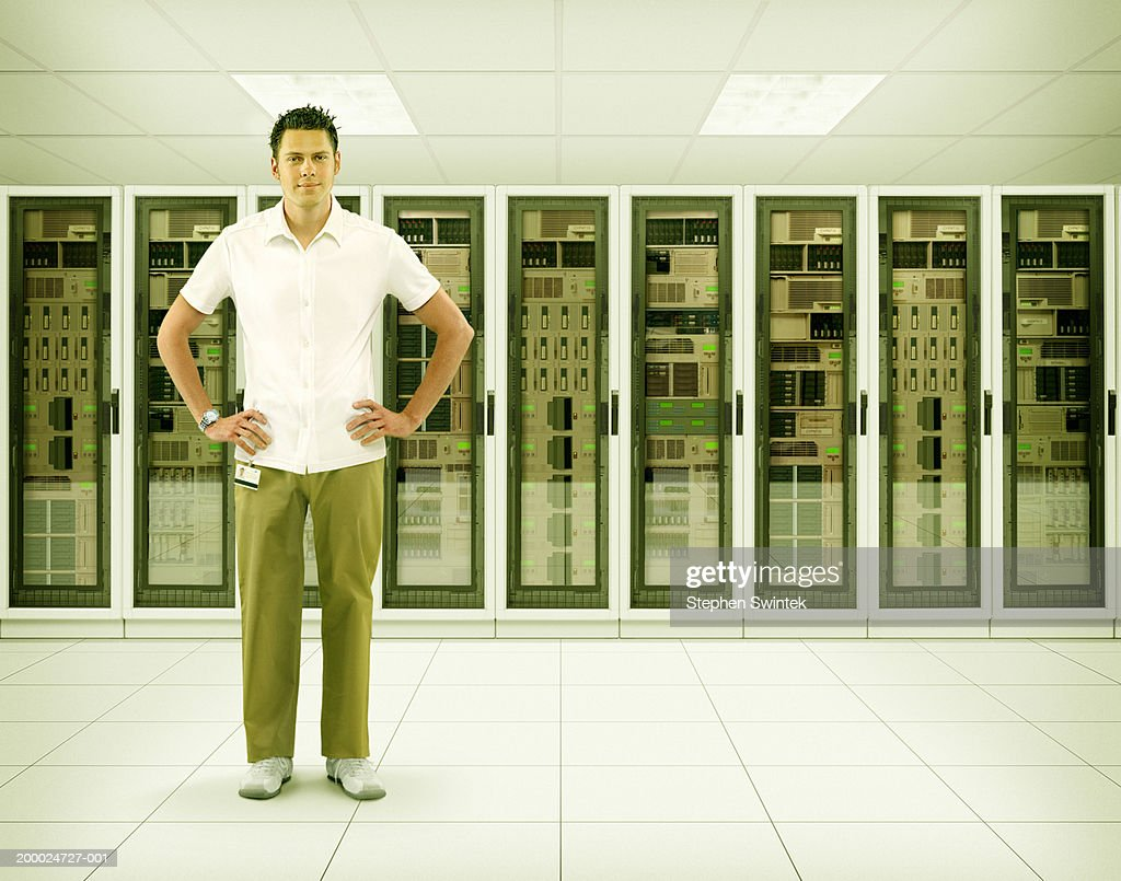 Man standing in server room (Digital Composite) : Stock Photo