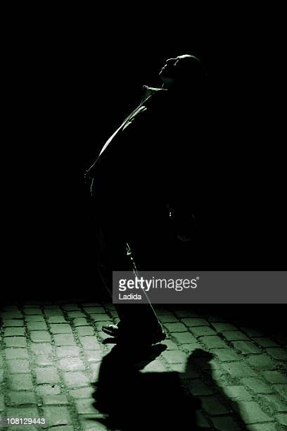 Man Standing in Shadows