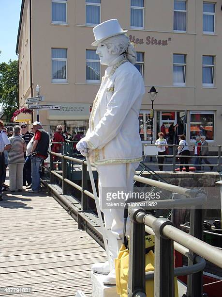 man standing like statue Rostock Germany