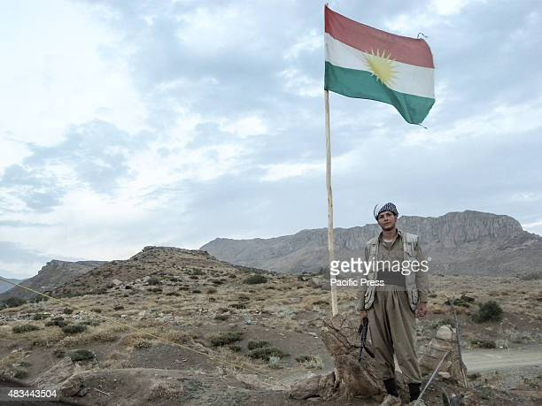 A man standing near a flag pole The PDKI movement is in Iranian borders one kilometer away from the Iranian troops and where the Peshmerga stays