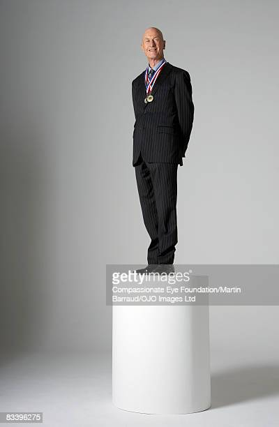 Man standing on a pedestal, wearing medals