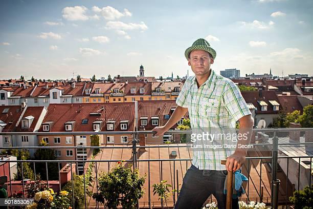 Man Standing On Balcony, Munich, Bavaria, Germany, Europe