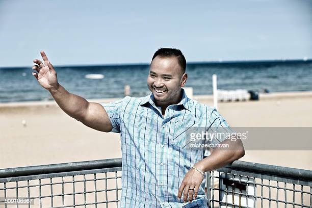 USA, Illinois, Cook County, Chicago, Man waving on beach