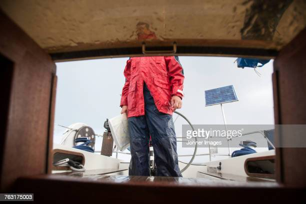 Man standing on boat deck
