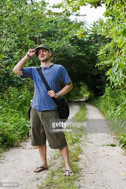 Man standing on dirt road