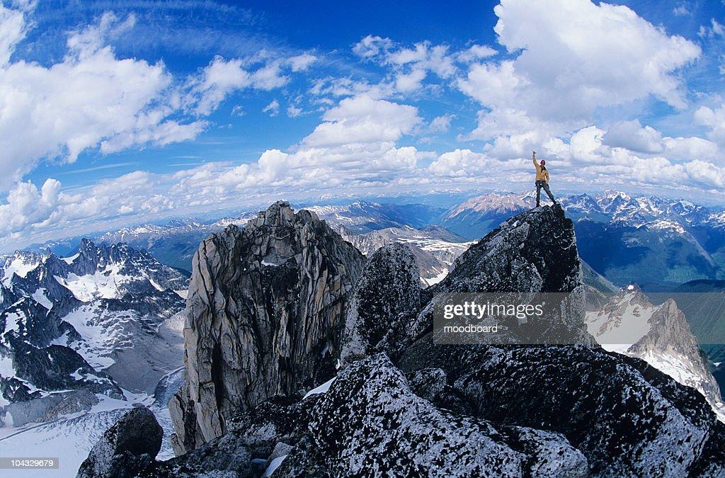 Man standing on mountain summit : Stock Photo
