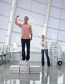 Man standing on moving boxes