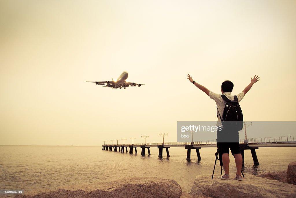 Man standing on rock : Stock Photo