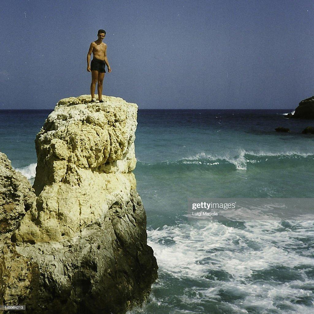 Man standing on rocks : Stock Photo