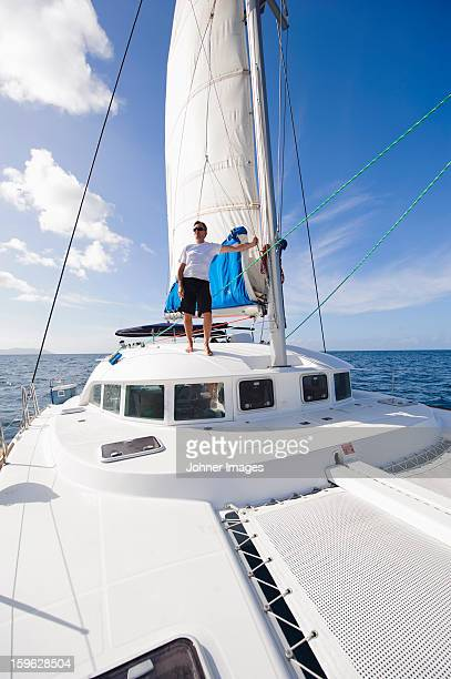 Man standing on sailing boat