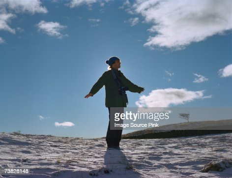 Man standing on sandy beach : Stock Photo