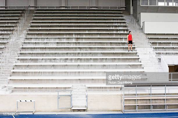 Man standing on stadium steps
