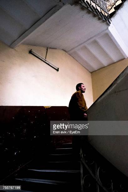 Man Standing On Steps In Building