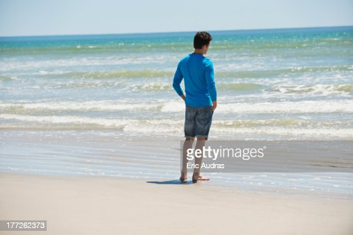 Man Standing On The Beach And Looking At The Sea Stock ...