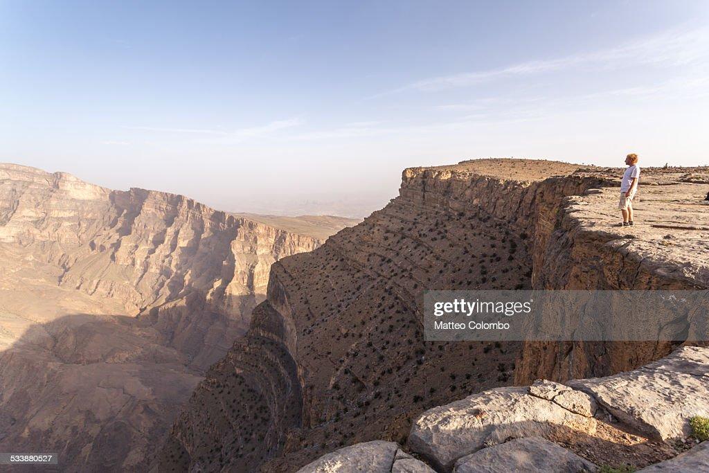 Man standing on the edge of Jebel Akhdar canyon