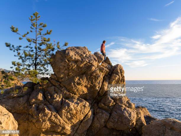 Man standing on top of a boulder