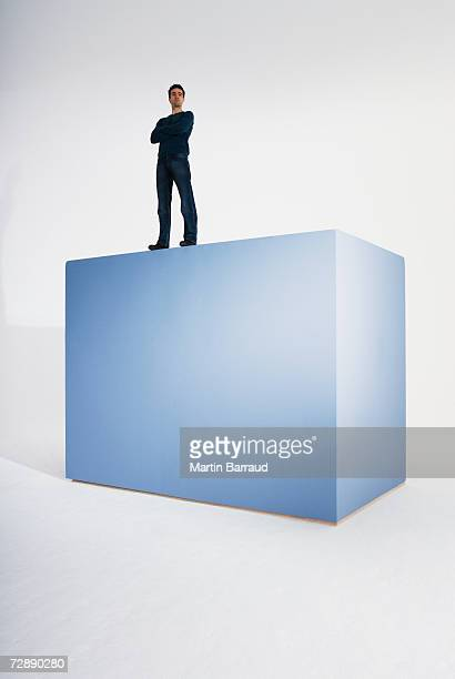 Man standing on top of giant box