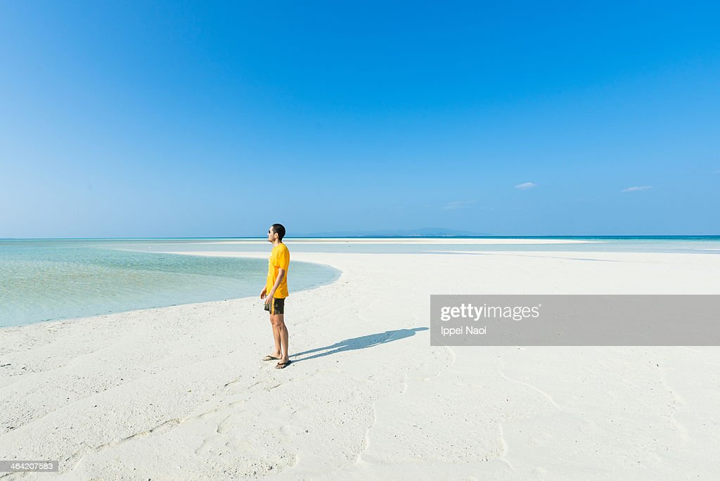 Man standing on tropical paradise beach, Okinawa