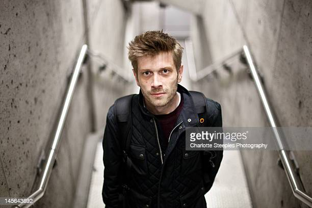 Man standing on underground staircase