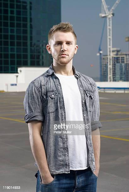 Man standing on urban rooftop