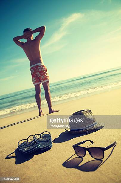 Man Standing On Vintage Vacation Beach