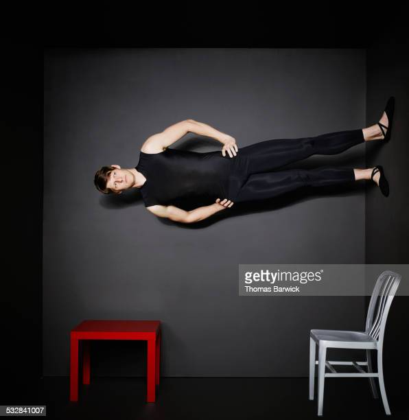 Man standing on wall in small room
