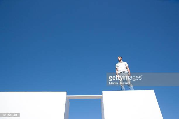 Man Standing on walls outdoors