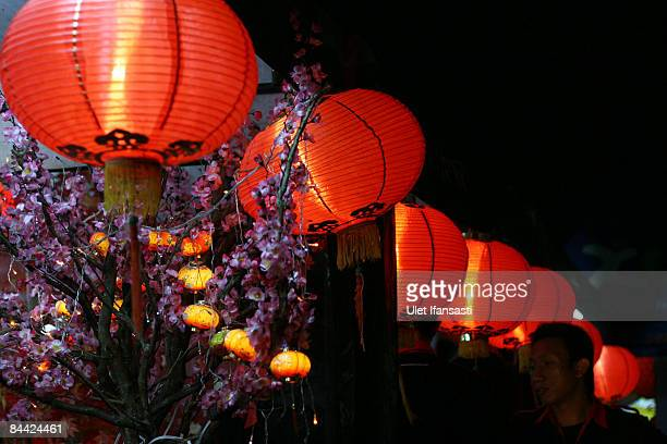 A man standing under lanterns as the ChineseIndonesian community celebrate the Chinese New Year or Imlek on January 23 2009 in Semarang Central Java...