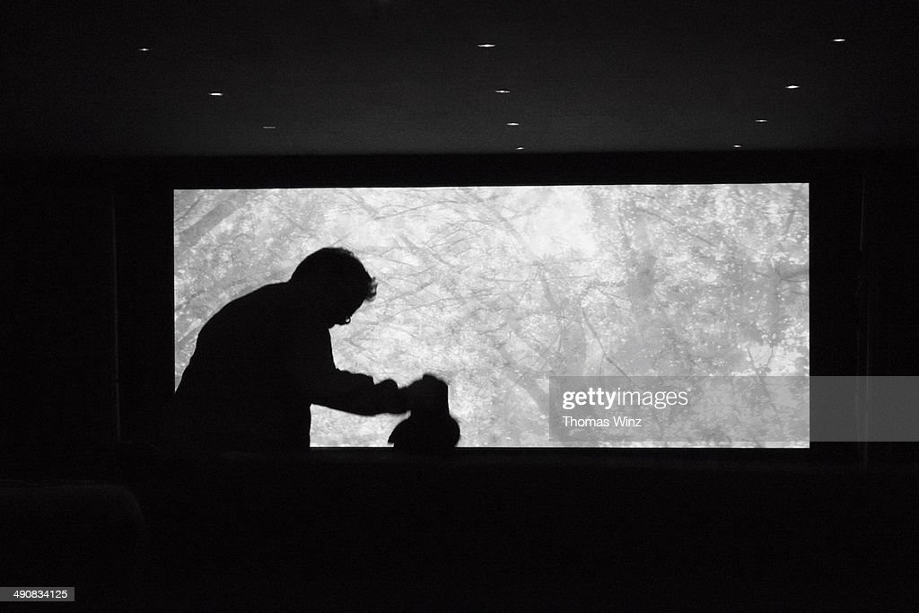 Man standing up in a movie theater