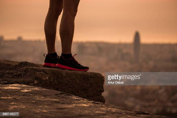 Man standing up on top of Barcelona viewpoint.