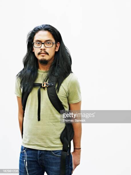 Man standing wearing backpack