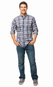 Full length portrait of a handsome young man standing with hands in pockets. Vertical shot. Isolated on white.