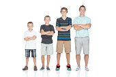 Man standing with his children in ascending order
