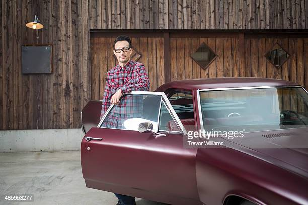 A man standing with his classic car
