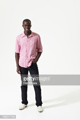 A man standing, with his hand in his pocket. : Stock Photo