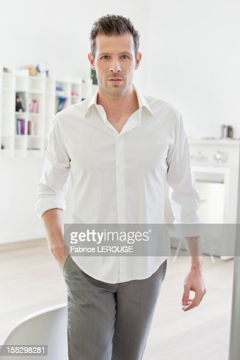 Man standing with his hands in his pockets