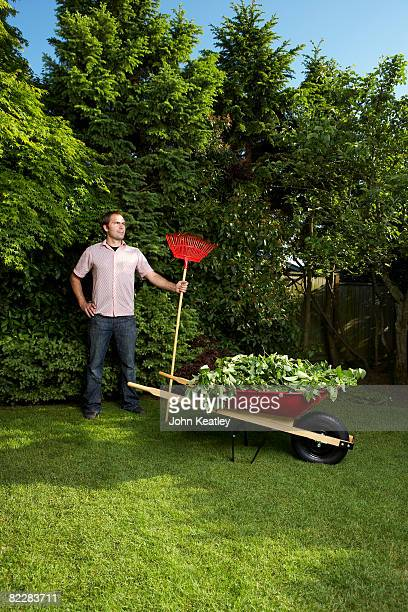 Man standing with rake