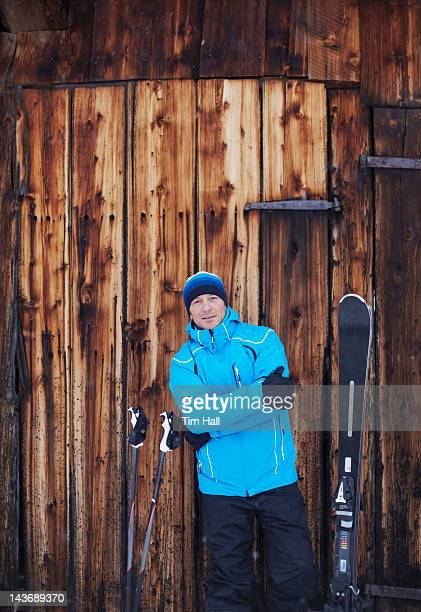 Man standing with skis and poles